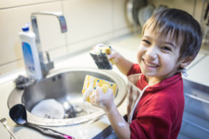 boy doing dishes and chores