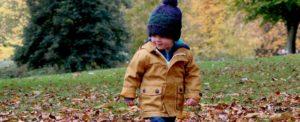 child walking in leaves