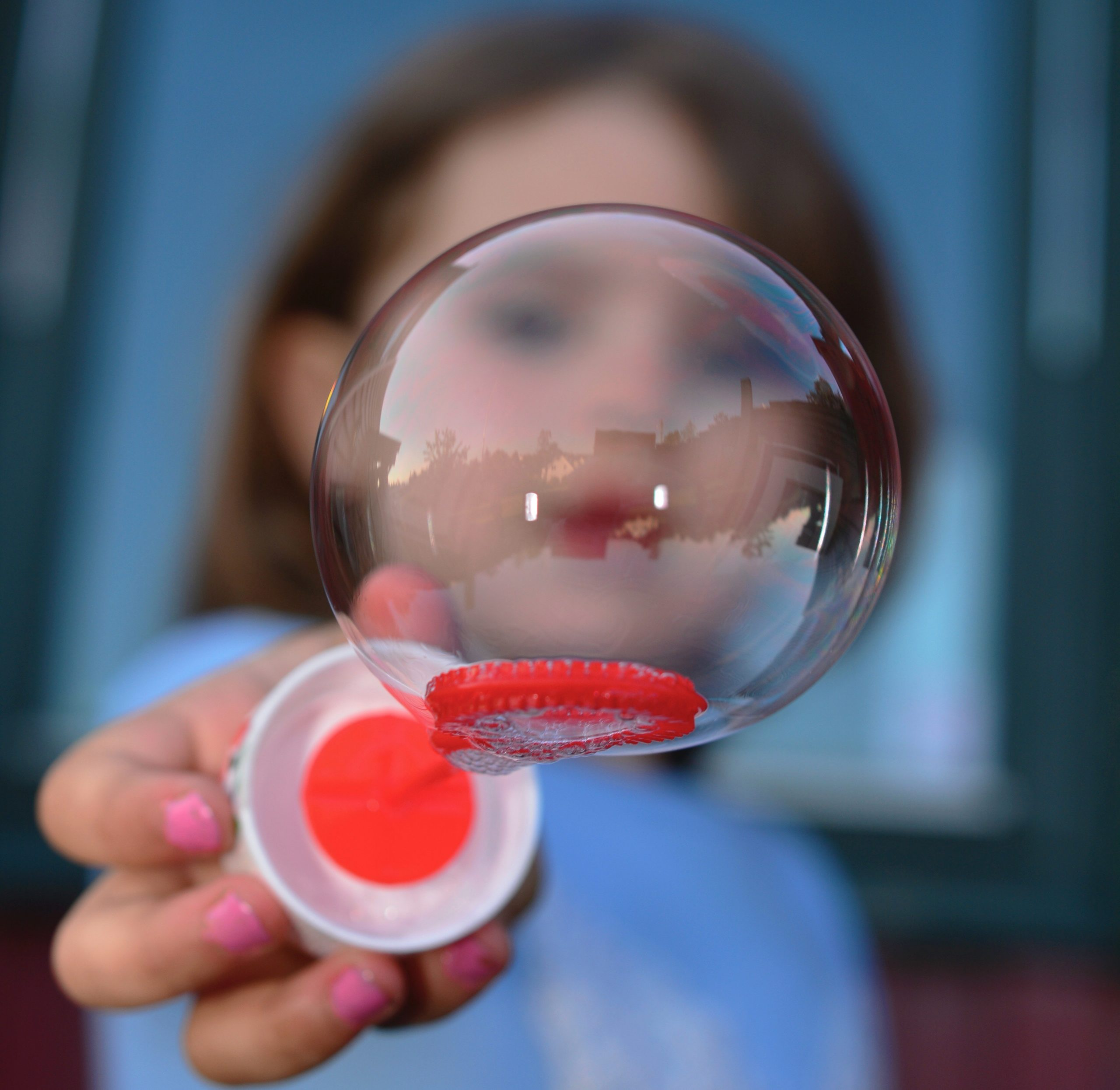 Picture of a child holding a bubble.